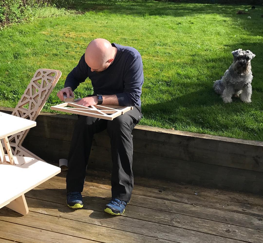 Taking advantage of the afternoon sunshine and sanding down prototype parts for photography tomorrow, with my loyal assistant, Baxter. #miniatureschnauzer #workingfromhome #homeoffice #workingoutside #laptopstand #standingdesk #standingdeskconverter #sanding #plywood #cnc #cncplywood #onemanandhisdog #productdesign #officefurniture