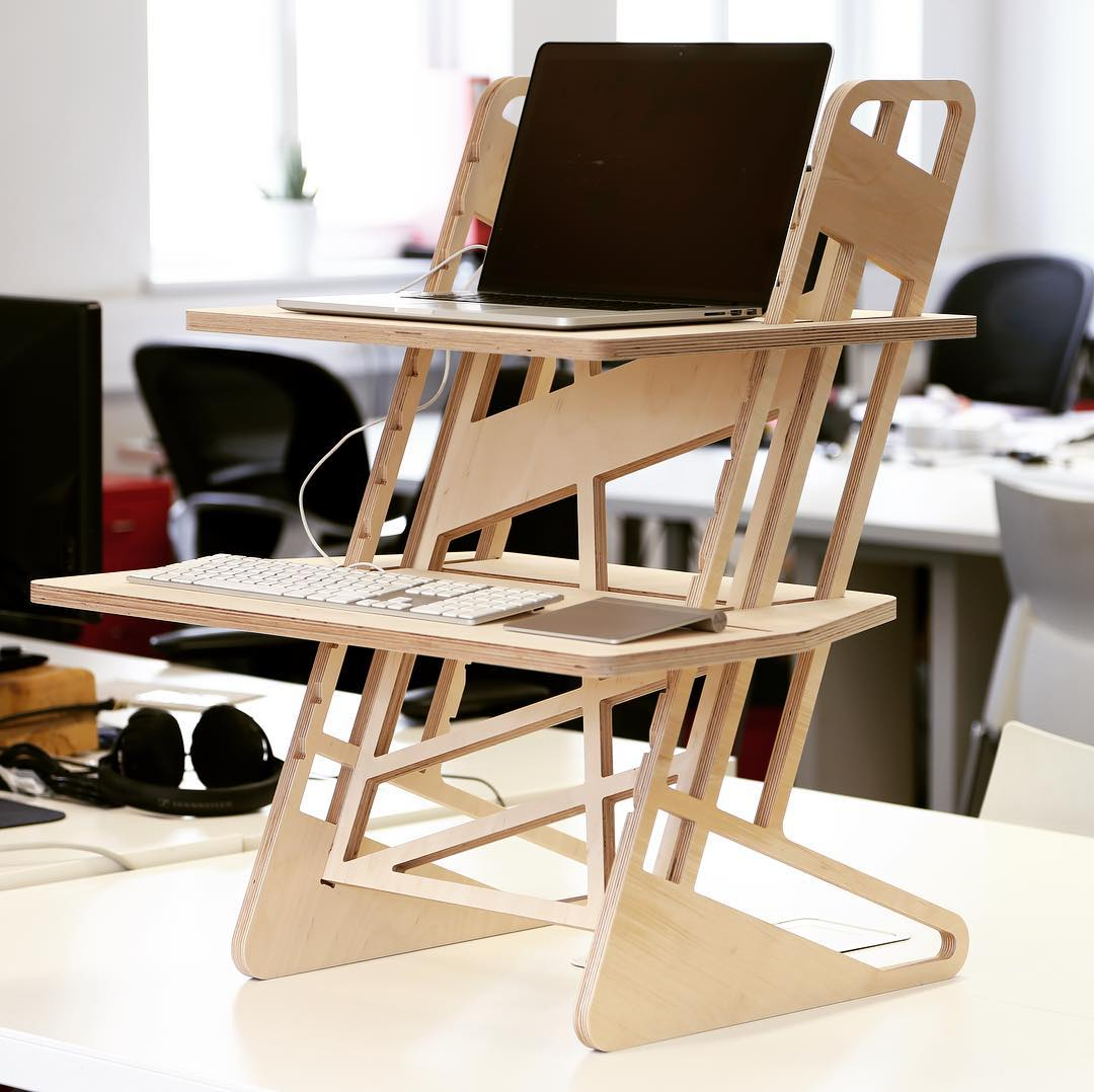 First prototype of our standing desk already hard at work #testing #standingdesk #coworking #officefurniture #productdesign #cncplywood #cnc #officeinterior #laptopstand #ergonomic