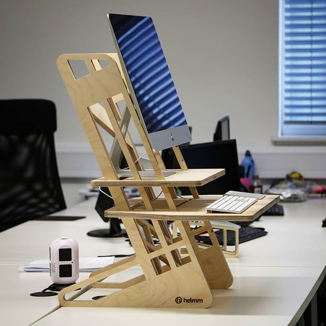 Side profile of our S-Desk 22 standing desk converter with a 27″ iMac on top. For the upwardly mobile creative professional, it's a perfect match