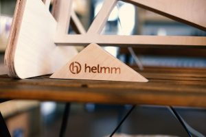Helmm logo branded onto plywood desk accessory