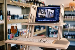 Wooden standing desk in a beer shop