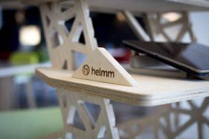 Helmm logo branded onto standing desk accessory