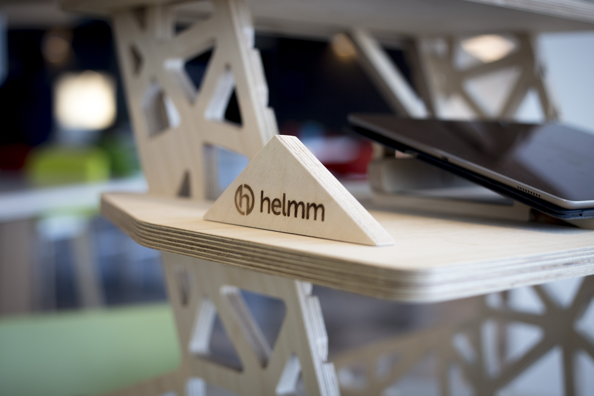 Helmm logo branded onto standing desk accessory